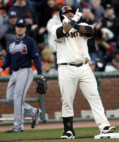San Francisco Giants' Pablo Sandoval gestures after his triple against the Atlanta Braves in the fourth inning of a baseball game, Sunday, April 11, 2010, in San Francisco. Photo: Dino Vournas, AP
