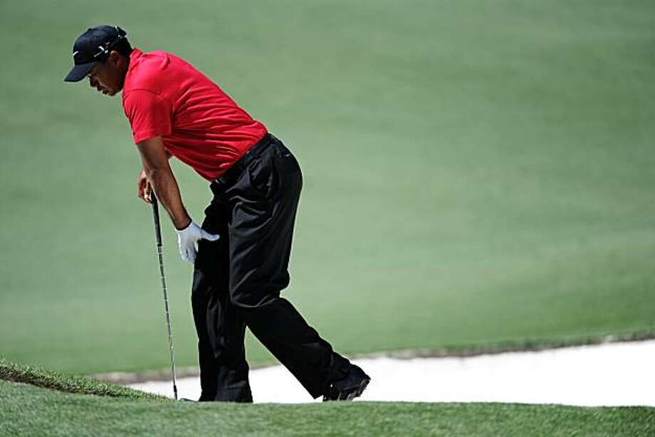AUGUSTA, GA - APRIL 11:  Tiger Woods reacts to a bunker shot on the second hole during the final round of the 2010 Masters Tournament at Augusta National Golf Club on April 11, 2010 in Augusta, Georgia. Photo: Harry How, Getty Images