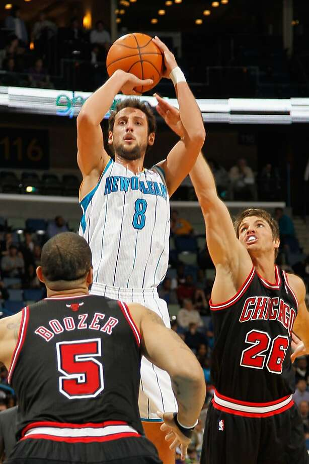 NEW ORLEANS, LA - FEBRUARY 08:  Marco Belinelli #8 of the New Orleans Hornets shoots the ball over Kyle Korver #26 and Carlos Boozer #5 of the Chicago Bulls at New Orleans Arena on February 8, 2012 in New Orleans, Louisiana.  NOTE TO USER: User expressly acknowledges and agrees that, by downloading and or using this photograph, User is consenting to the terms and conditions of the Getty Images License Agreement.  (Photo by Chris Graythen/Getty Images) Photo: Chris Graythen, Getty Images