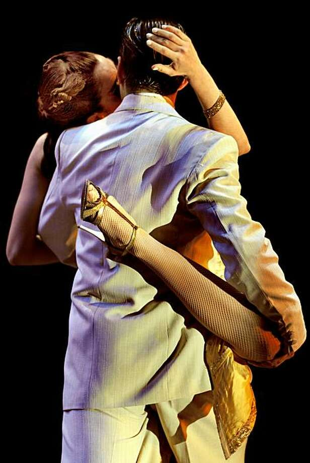 (FILES) In this file picture taken on August 31, 2009 a couple dances the Tango during the final round of the Stage Tango competition at the VII Tango Dance World Championship in Buenos Aires.  The United Nations on September 30, 2009 declared the tango tradition of Argentina and Uruguay a world cultural treasure, adding its sultry dance steps and melancholy song lyrics to UNESCO's heritage list.  AFP PHOTO/DANIEL GARCIA (Photo credit should read DANIEL GARCIA/AFP/Getty Images) Photo: Daniel Garcia, AFP/Getty Images