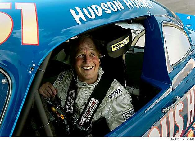 "In this May 24, 2006 file photo, actor Paul Newman smiles at H.A. ""Humpy"" Wheeler, president of Lowe's Motor Speedway in Concord, N.C.,  after driving several laps around the speedway in a 1951 Hudson Hornet. Photo: Jeff Siner, AP"