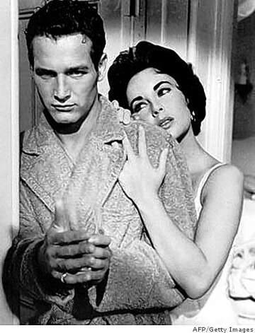 "(FILES) -- A file photo shows US actors Paul Newman (L) and Elizabeth Taylor (R) in a scene from the 1958 Hollywood film ""Cat on a Hot Tin Roof"". Oscar-winning screen legend and philanthropist Paul Newman has died of cancer at 83, his foundation announced on September 27, 2008. Photo: AFP/Getty Images"