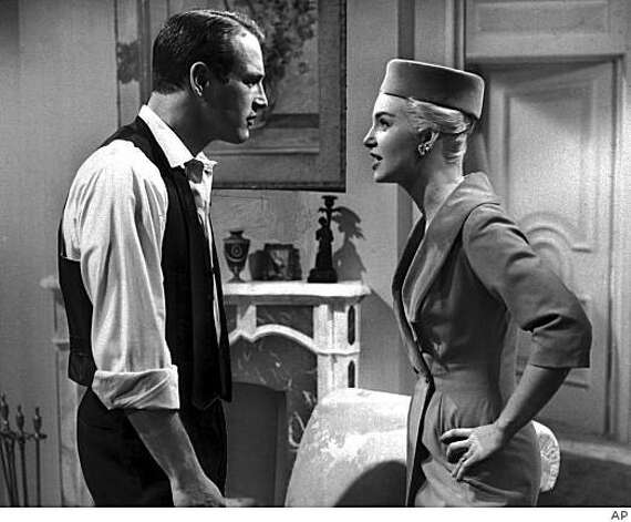 "** FILE ** In this 1960 file photo, actors Paul Newman, left, and Joanne Woodward appear in character in this scene from the film ''From the Terrace.''  Newman, the Academy-Award winning superstar who personified cool as an activist, race car driver, popcorn impresario and the anti-hero of such films as ""Hud,"" ""Cool Hand Luke"" and ""The Color of Money,"" has died, a spokeswoman said Saturday. He was 83. Newman died Friday, Sept. 26, 2008, of cancer, spokeswoman Marni Tomljanovic said. Photo: AP"