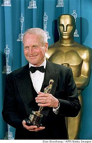 Paul Newman poses with the Jean Hershholt Humanitarian Award which was presented to him during the 66th Annual Academy Awards in 1994. Photo: Dan Groshong, AFP/Getty Images
