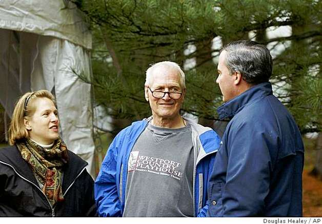 Paul Newman, center, with his daughter Lissy Newman, left, talk with Connecticut Gov. John Rowland, right, before a ceremony to celebrate the largest open space land acquistion in Connecticut's history in Redding, Conn. Monday, April 22, 2002. Photo: Douglas Healey, AP