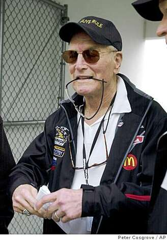 "Sporting a hat that reads ""Old Guys Rule,"" actor Paul Newman arrives for the drivers meeting at the Daytona International Speedway in Daytona Beach, Fla., Thursday, Feb. 3, 2005. Newman, 80, will be part of the team driving a Ford Crawford in the Rolex 24 to be run Saturday. Photo: Peter Cosgrove, AP"