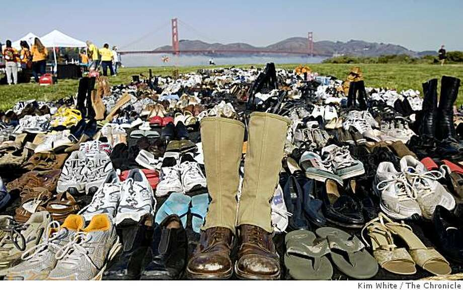 A pair of WWI boots sit at the head of 1,300 pairs of shoes in memory of the first person, who was a vetran of WWI, that committed suicide by jumping off the Golden Gate Bridge in San Francisco , Calif., on Saturday, September 27, 2008. More than 1,300 shoes were layed down near the Golden Gate Bridge in memory of those who died from jumping from the bridge since 1937. Photo: Kim White, The Chronicle