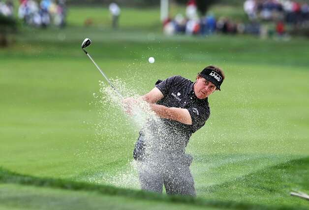Phil Mickelson safely hits a sand shot onto the seventh green at the Monterey Peninsula Country Club during the second round of the AT&T Pebble Beach National Pro-Am golf tournament in Pebble Beach, Calif., Friday, February 10, 2012. Photo: Lance Iversen, The Chronicle
