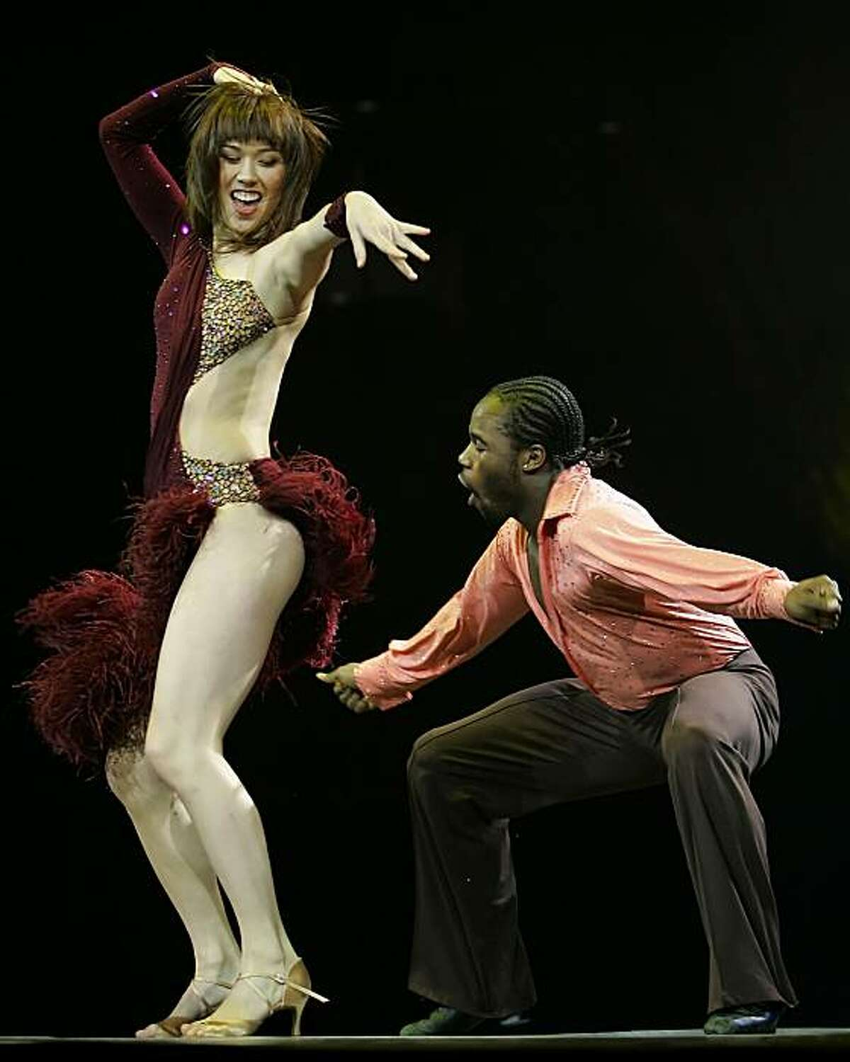 Katee Shean, left, and Joshua Allen, right, performs a Samba dance during the popular FOX reality series So You Think You Can Dance tour performance at HP Pavilion in San Jose, Calif., on Thursday, Sept. 25, 2008.