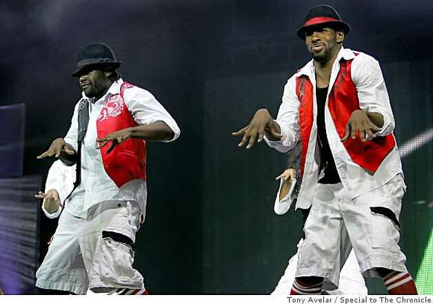 Joshua Allen, left, and fellow dancer Stephen (Twitch) Boss, right, perform in the popular FOX reality series So You Think You Can Dance, at HP Pavilion in San Jose, Calif. Photo: Tony Avelar, Special To The Chronicle