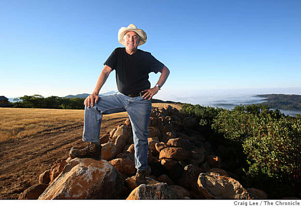 Winemaker John Kongsgaard at his new vineyard site in the Atlas Peak area in Napa, Calif., on September 12, 2008. The rocks and boulders he is standing on were cleared from the field on the left which will be his new vineyard.