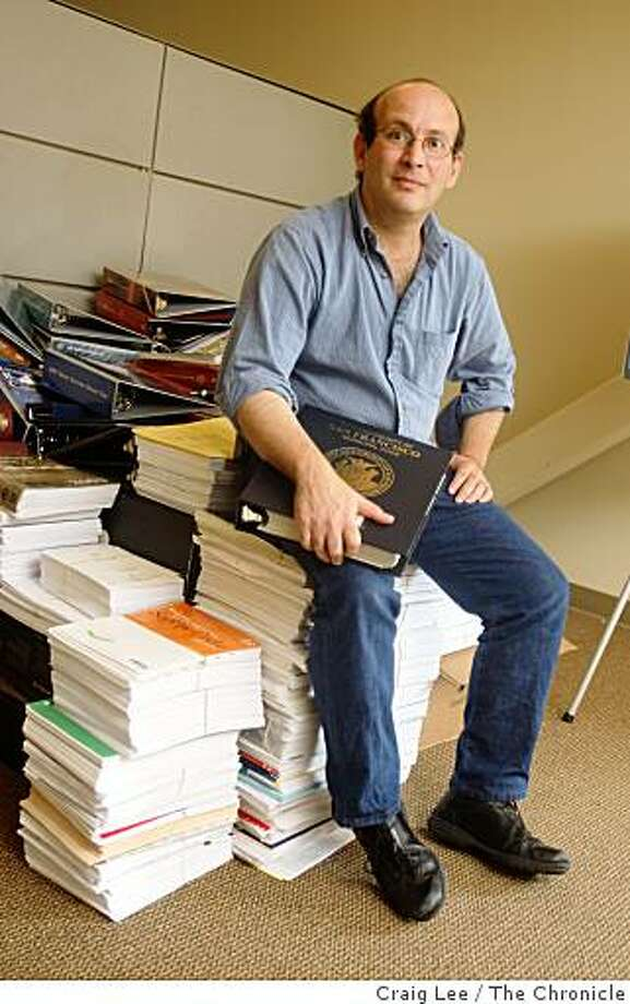 Carl Malamud of public.resource.org, sits on top of a stack of state and federal codes in Sebastopol, Calif., on September 17, 2008. He has been scanning these codes normally cost hundreds or thousands of dollars and posting them on his website free of charge. The government owners of the copyrights for those codes say they are protecting a valuable public property, but Malamud argues that laws created by the public should be available to the public Photo: Craig Lee, The Chronicle