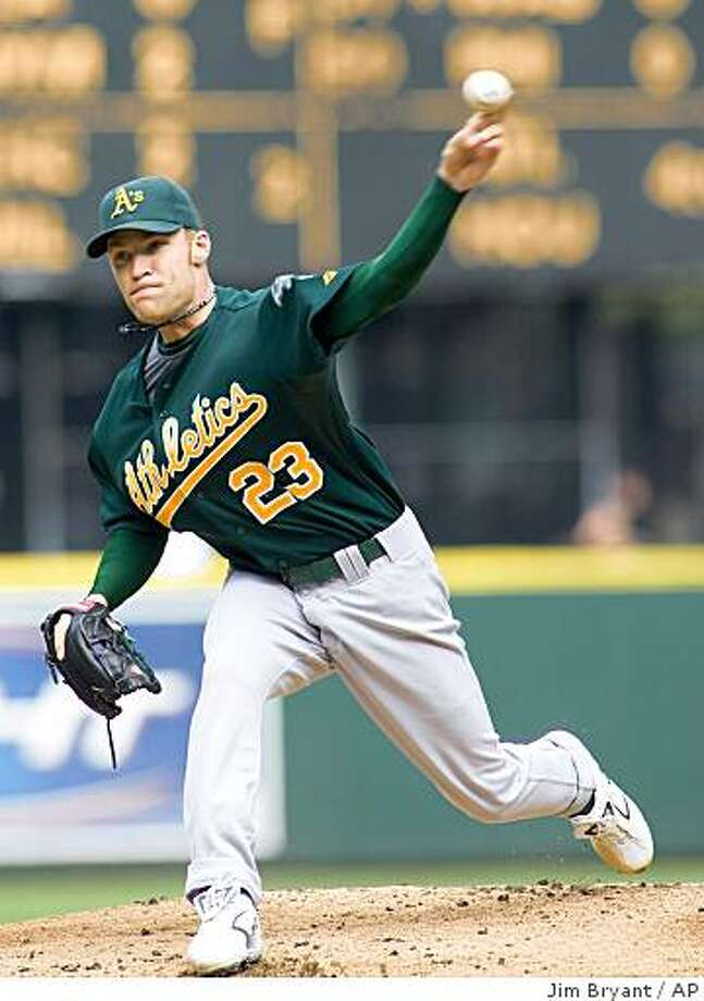 Oakland Athletics' starter Greg Smith delivers a pitch against the Seattle Mariners in the first inning of a baseball game in Seattle on Saturday, Sept. 27, 2008. (AP Photo/Jim Bryant) Photo: Jim Bryant, AP