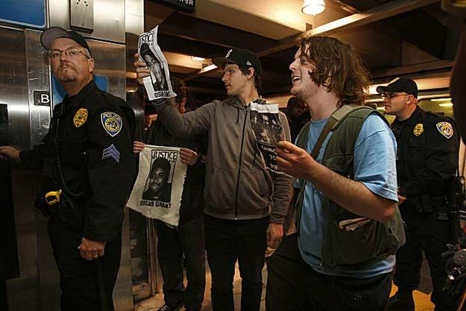A group of about two dozen protest the Oscar Grant incident, as tactical police secure the passenger platform at the Bart  station in the Embarcadero in San Francisco, Calif., on Thrusday, April 8, 2010. Photo: Liz Hafalia, The Chronicle