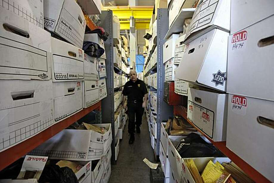 San Francisco police Sgt. Mark McDonough, supervisor of property control,  walks through the many rows of stored evidence, on Thursday Apr. 2010, items that are being stored inside the crime lab evidence warehouse in San Francisco, Calif. Photo: Michael Macor, The Chronicle