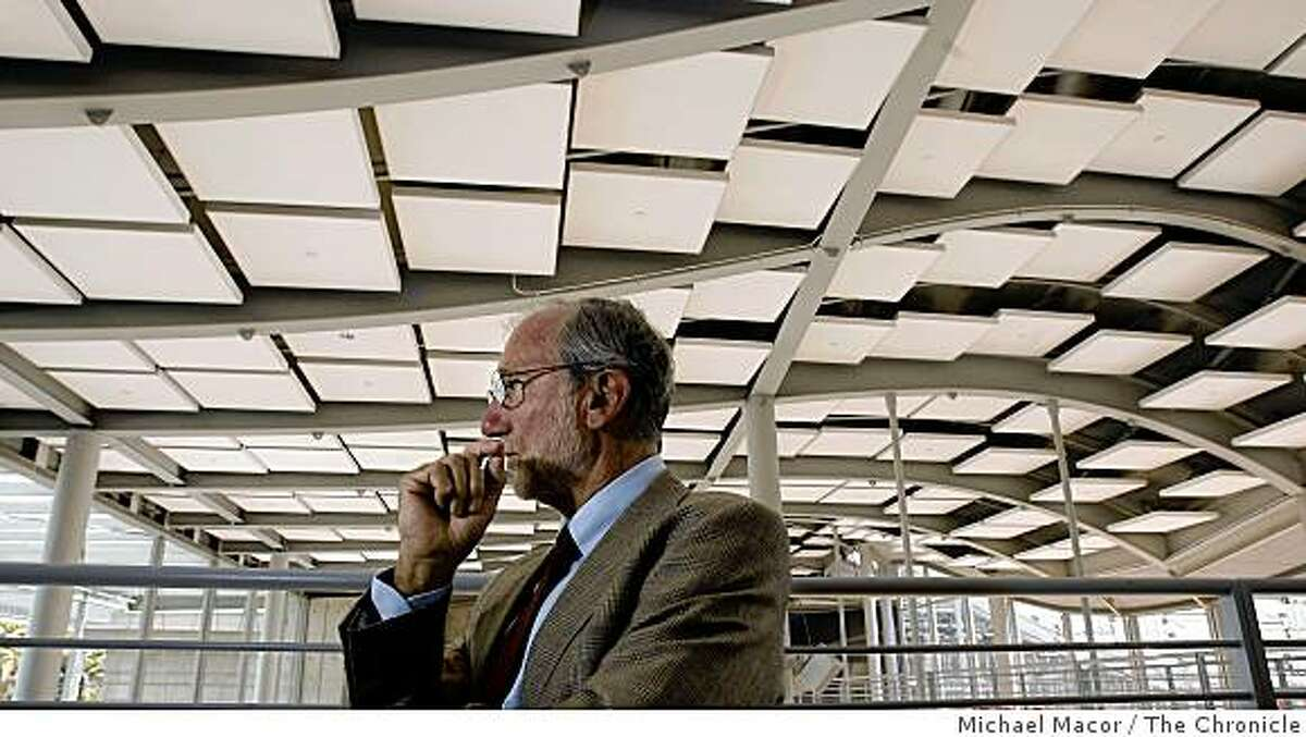 Renzo Piano stands near the center court atrium area of the building.