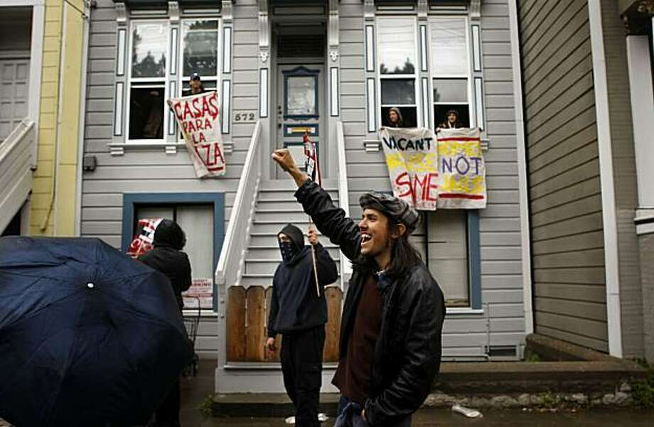Aaron Salazar chants as Homes Not Jails protesters demonstrate outside a vacant house on San Jose Street on Sunday in San Francisco. Photo: Lacy Atkins, The Chronicle