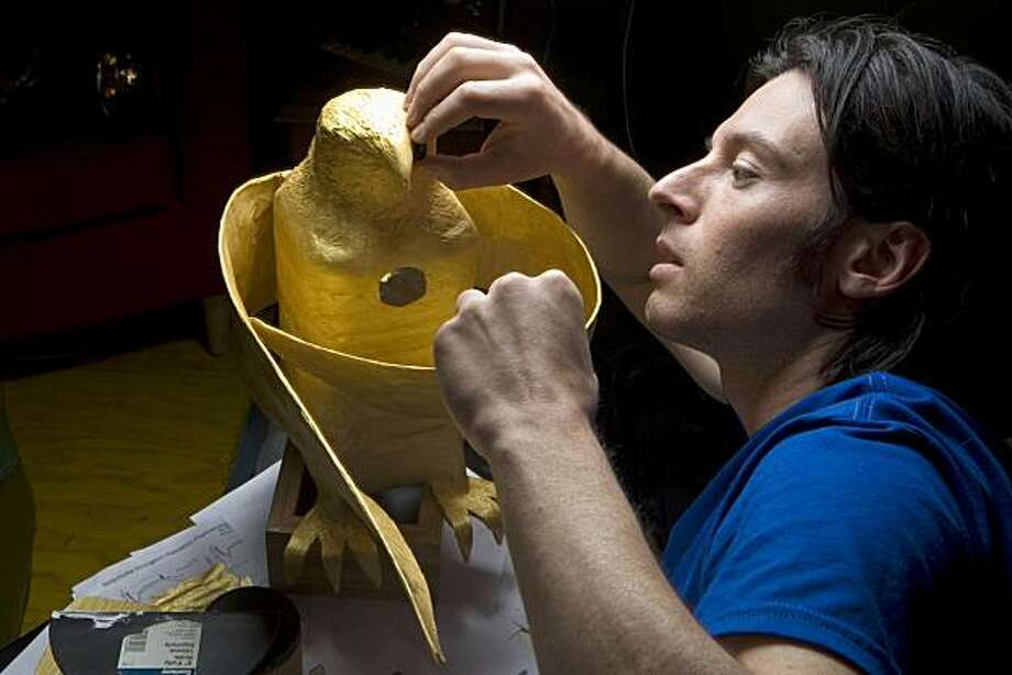 Film maker / musician / multimedia performance artist, Brent Bishop, works on a golden falcon he created in his studio at Million Fishes in San Francisco on Friday, April 2, 2010.  The falcon will be a prop in a group performance by the on Saturday night, April 3. Kat Wade / Special to the Chronicle Photo: Kat Wade, Special To The Chronicle