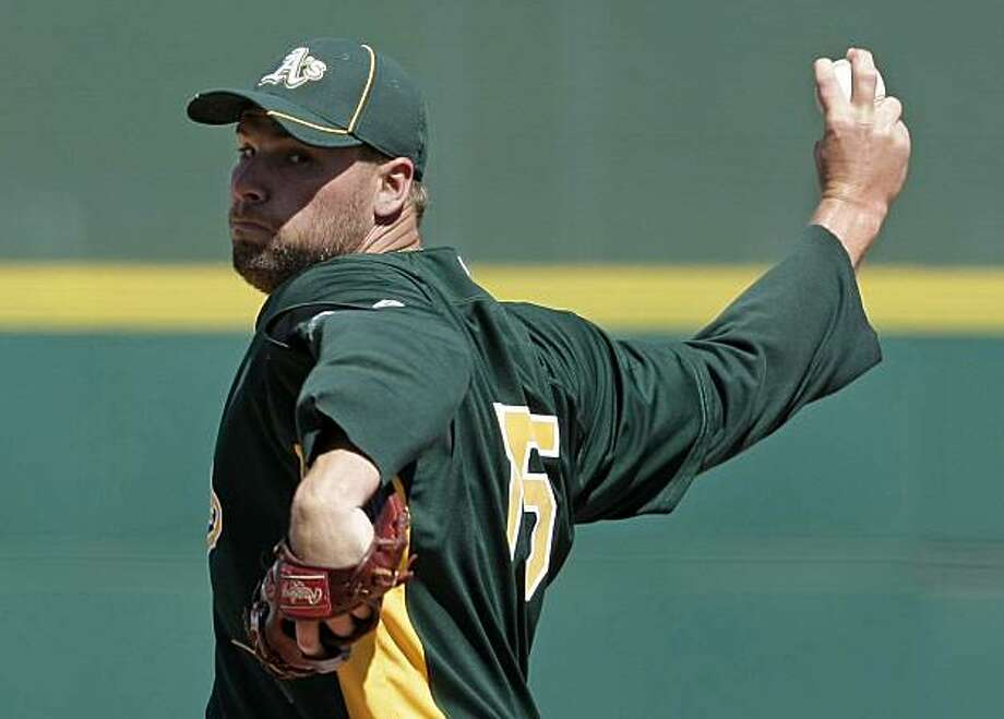Oakland Athletics' Ben Sheets pitches to the Cincinnati Reds in the first inning of a spring training baseball game Monday, March 15, 2010 in Goodyear, Ariz. The Reds won 13-5. Photo: Tony Dejak, AP