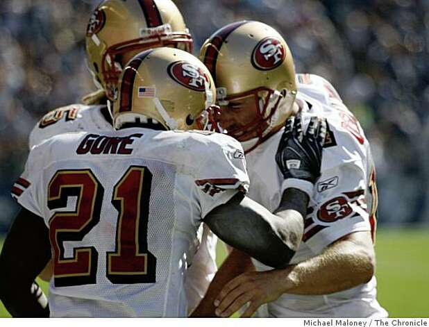 San Francisco 49ers Frank Gore (21) is congratulated by quarterback J.T. O'Sullivan (14) with a head butt after Gore's 3rd quarter TD. Photo: Michael Maloney, The Chronicle