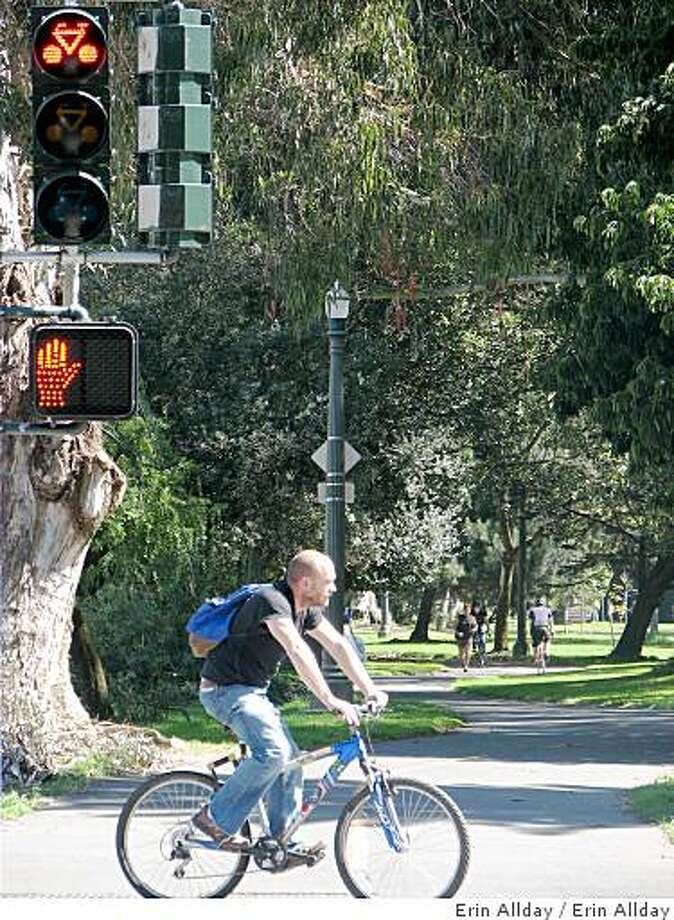 A cyclist stops at the new red bicylce light at Fell Street and Masonic Avenue. Photo: Erin Allday