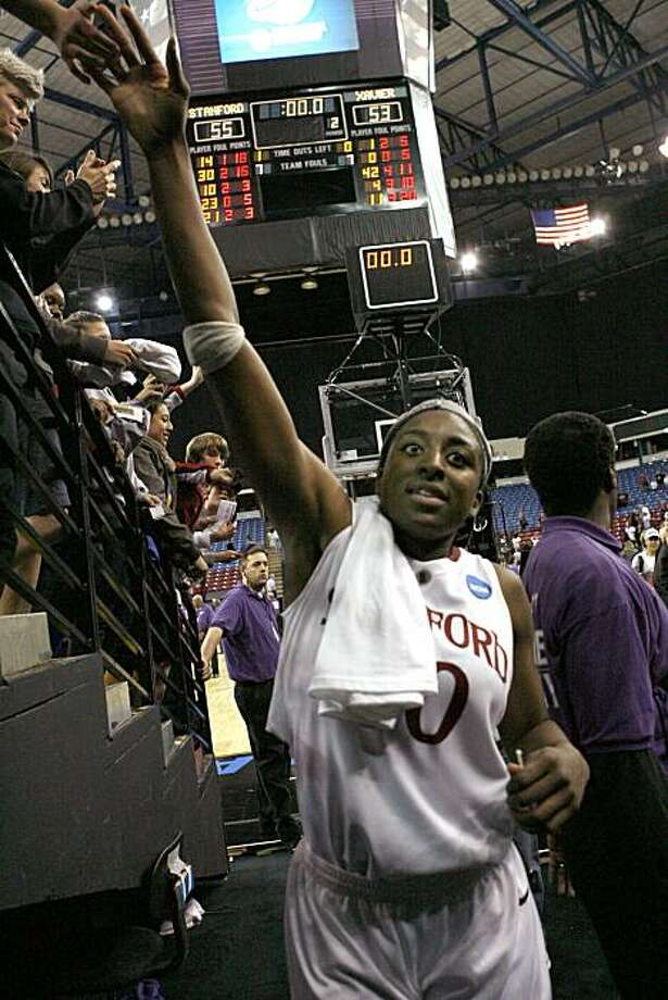 Stanford's Nnemkadi Ogwumike greets fans as she walks off the court after Stanford defeated Xavier 55-53 at the buzzer in the final of the NCAA college basketball tournament Sacramento Regional in Sacramento, Calif., Monday, March 29, 2010. Photo: Steve Yeater, AP