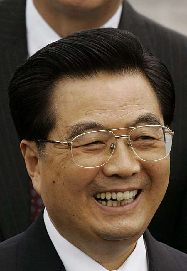 In a June 29, 2007 file photo China's President Hu Jintao smiles after arrival to Hong Kong airport.  Chinese President Hu Jintao will attend a summit on nuclear security in the United States this month, the Foreign Ministry said Thursday, April 1, 2010, signaling an easing of strained relations between the countries. Photo: Kin Cheung, AP