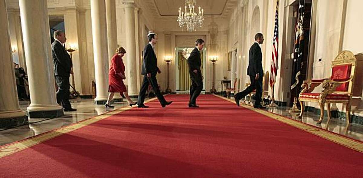President Barack Obama, far right, walks back after delivering a statement on his budget that he sent to Congress, Monday, Feb. 1, 2010, in the Grand Foyer of the White House in Washington. From left are, chief economic adviser Lawrence Summers, Council of Economic Council Chair Christina Romer, Budget Director Peter Orszag, and Treasury Secretary Timothy Geithner, and the president.