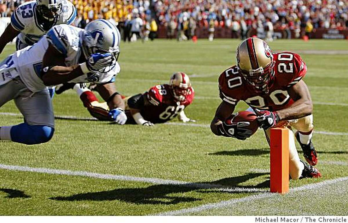 San Francisco 49ers Allen Rossum (20) just gets into the endzone on a 4th and goal in the last quarter to seal a San Francisco victory, 31-13, Detroit Lions Kalvin Pearson (24) just late on the tackle, as San Francisco 49ers take on the Detroit Lions in NFL action at Candlestick Park in San Francisco, Calif. on Sunday Sept. 21, 2008.