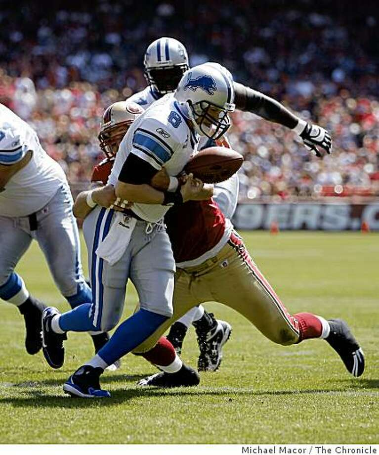 San Francisco 49ers Justin Smith (94) knocks the ball loose from Detroit Lions quarterback Jon Kitna (8) in the first quarter, the ball was recovered by the lions, as San Francisco 49ers take on the Detroit Lions in NFL action at Candlestick Park in San Francisco, Calif. on Sunday Sept. 21, 2008. Photo: Michael Macor, The Chronicle