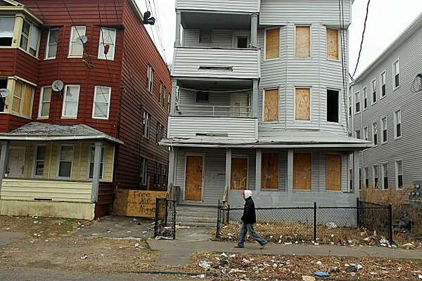 BRIDGEPORT, CT - MARCH 12: An abandoned property is boarded up on March 12, 2010 in Bridgeport, Connecticut. A new report by RealtyTrac Inc. announced that the number of foreclosed homes in Connecticut, one of the nation's wealthiest states, is up 3.4 percent from January to February of this year. Nationwide foreclosures have decreased by two percent from January to February. The report, which was released yesterday, says there were nearly 2,300 foreclosure filings in Connecticut last month, compared withnearly 2,200 in January.