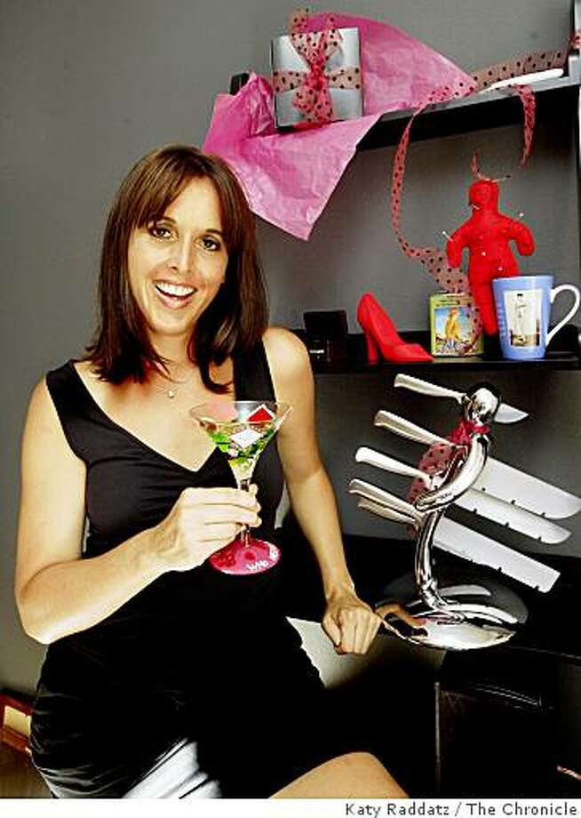 Angie Schmidt is the owner of Smashing Katie, an online store that sells quirky, humorous gifts to women who have gone through a breakup or divorce, such as a voodoo doll pincushion, a coffin for a wedding ring, an Ex knife block, a whisky flask with a funny label, a rubber door stop shaped like a shoe, hand painted wine and martini glasses, and ribald pink underwear, in South San Francisco, Calif. on  Thursday Sept. 18, 2008 Photo: Katy Raddatz, The Chronicle