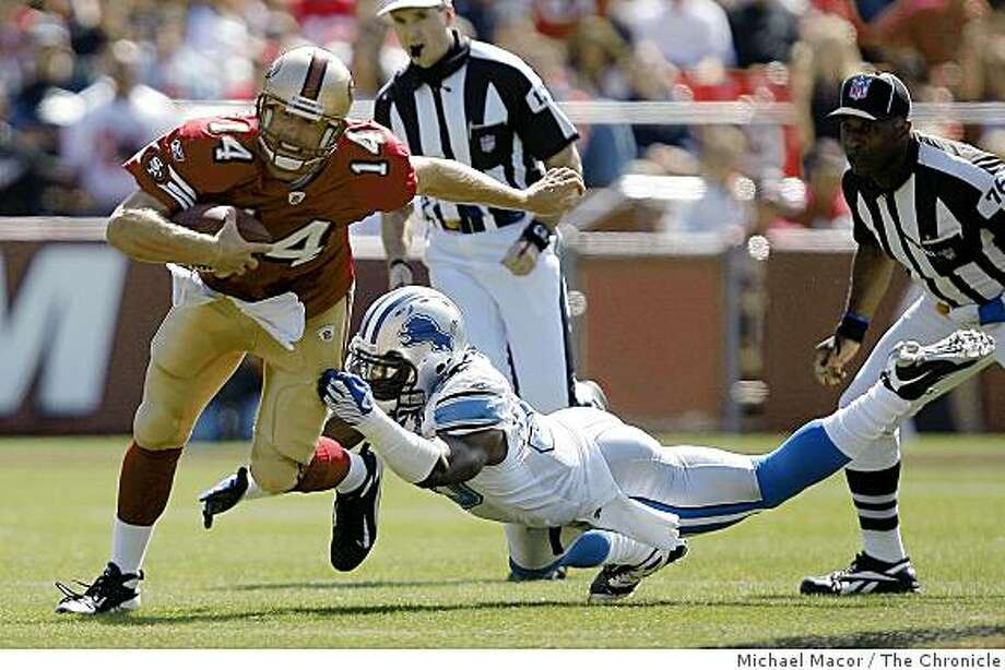 San Francisco 49ers quarterback J.T. O'Sullivan (14) picks up a first down in the 1st quarter getting by Detroit Lions Ernie Sims (50), as San Francisco 49ers take on the Detroit Lions in NFL action at Candlestick Park in San Francisco, Calif. on Sunday Sept. 21, 2008. Photo: Michael Macor, The Chronicle