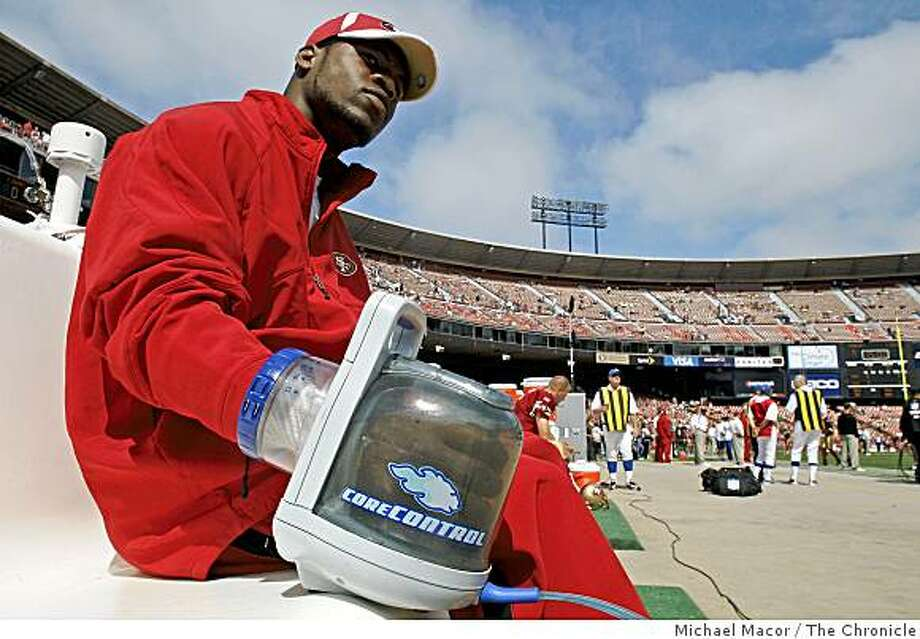 San Francisco 49er, Marcus Hudson, demonstrates the RTX Rapid Thermal Exchanger which is used on the sidelines during football games the cramping of the muscles of players as well as lowering the core temperatures of overheated athletes, at Candlestick Park in San Francisco, Calif. on Sunday Sept. 21, 2008. Photo: Michael Macor, The Chronicle
