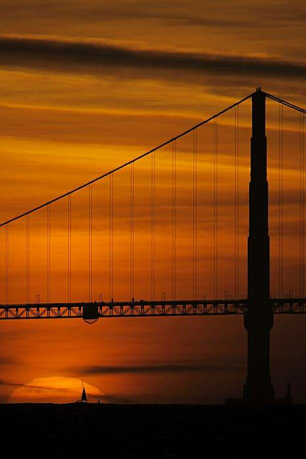 The sun sets behind the Golden Gate Bridge in San Francisco, Calif., on Sunday, March 14, 2010. As the jet stream continues to move north, the SF Bay Area will be graced by sunshine the last week of winter, with temperatures expected to be near the 70s by the end of the week. Photo: Carlos Avila Gonzalez, The Chronicle