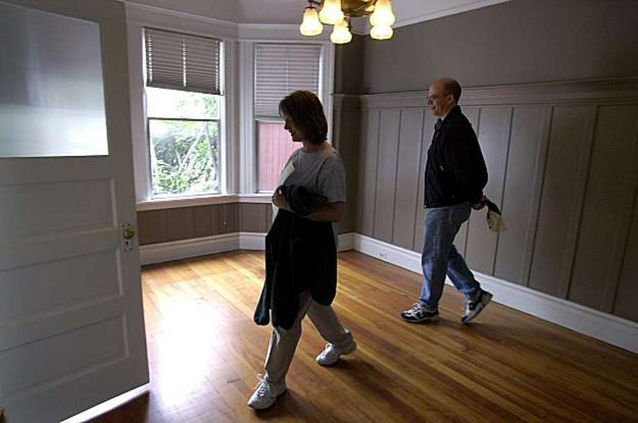 "Home buyers Steve and Judy Lewicky of San Francisco  peruse dining room during an ""open home"" showing the flat offered at 335 Clipper Street in San Francisco. Photo: Darryl Bush, The Chronicle"