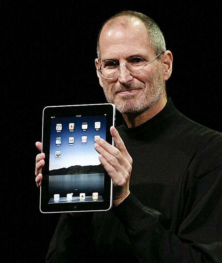 "(FILES) Dated January 27, 2010 filed photo shows Apple Inc. CEO Steve Jobs announces the new iPad as he speaks during an Apple Special Event at Yerba Buena Center for the Arts San Francisco, California. US media outlets April 1, 2010 gushed over the AppleiPad in early hands-on reviews ahead of its much-anticipated sales launch at the weekend.  ""This beautiful new touch-screen device from Apple has the potential to change portable computing profoundly, and to challenge the primacy of the laptop,"" said theWall Street Journal, calling it a ""game changer.""  FILES/ Photo: Ryan Anson, AFP/Getty Images"