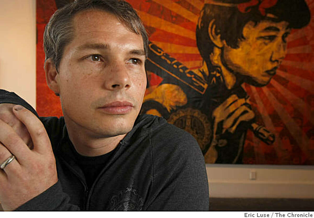 Artist Shepard Fairey at his exhibit The Duality of Humanity with one mural piece from the show in San Francisco photographed on Thursday, September 11, 2008.