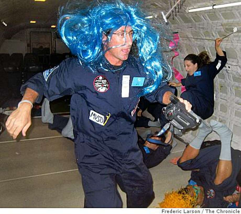 Jeff Koenig (wig) a middle school science teachers from L.A conduct a science experiment on board a Boeing 727 jet named G-Force 1 out of San Jose., Calif which enable passengers to experience zero gravity on September 18, 2008. Photo: Frederic Larson, The Chronicle