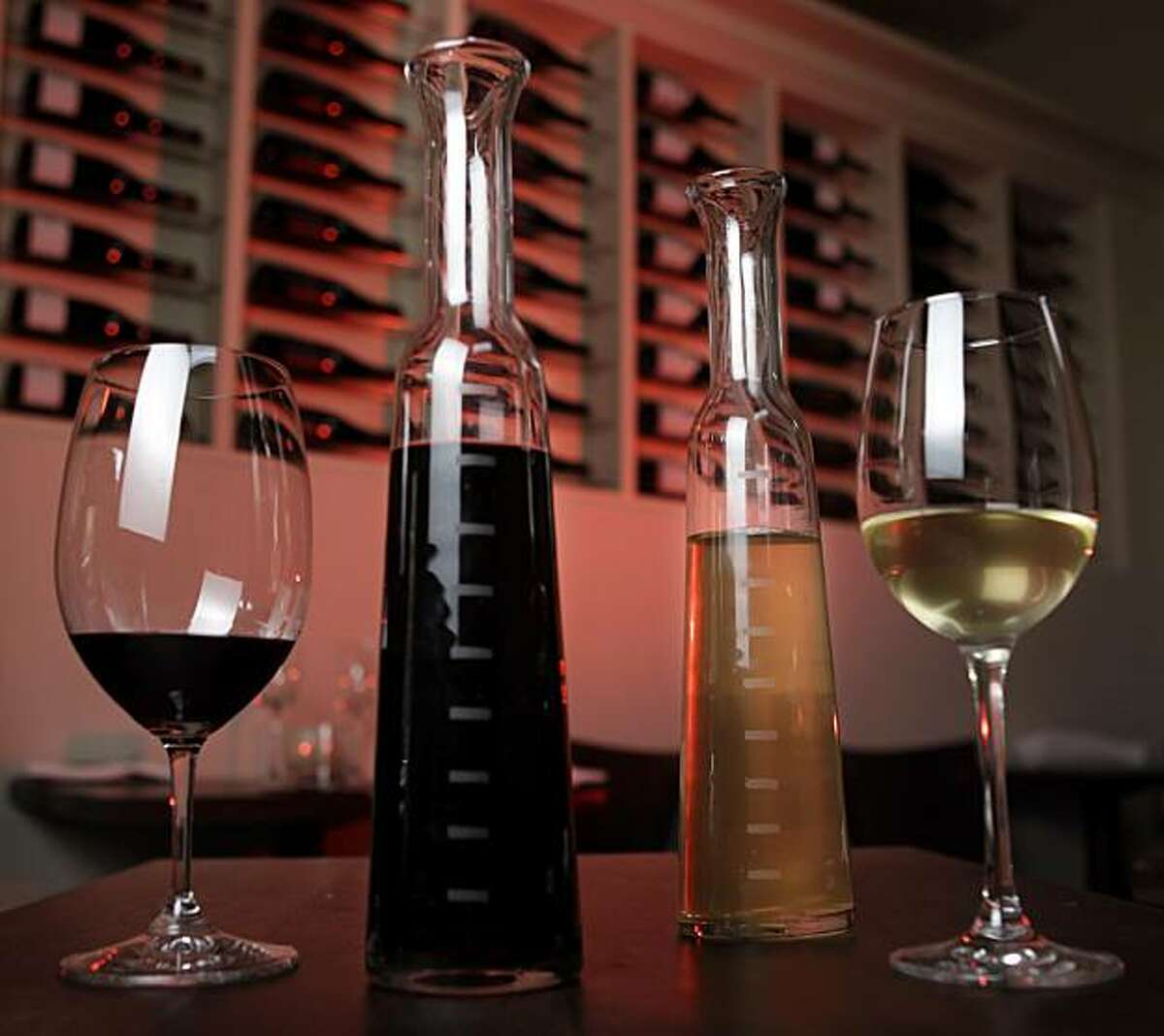 A bottle of red and white blend wine are what is served as the house wines on tap at Frances restaurant, March 28, 2010, in San Francisco, Calif. The bottles are marked every two ounces and are charged one dollar an ounce.