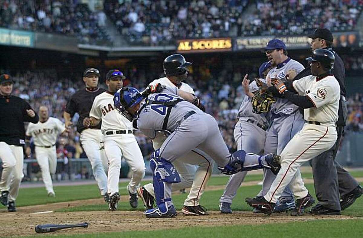 Los Angeles Dodgers reliever Eric Gagne, third from right, is held by teammate Adrian Beltre and San Francisco Giants' Ray Durham as Dodgers catcher Paul LoDuca holds San Francisco Giants' Michael Tucker in the ninth inning on Thursday, June 24, 2004, in San Francisco. Tucker rushed the mound after being knocked down by a pitch from Gagne causing a bench-clearing brawl. Giants won, 9-3. This photo is included in