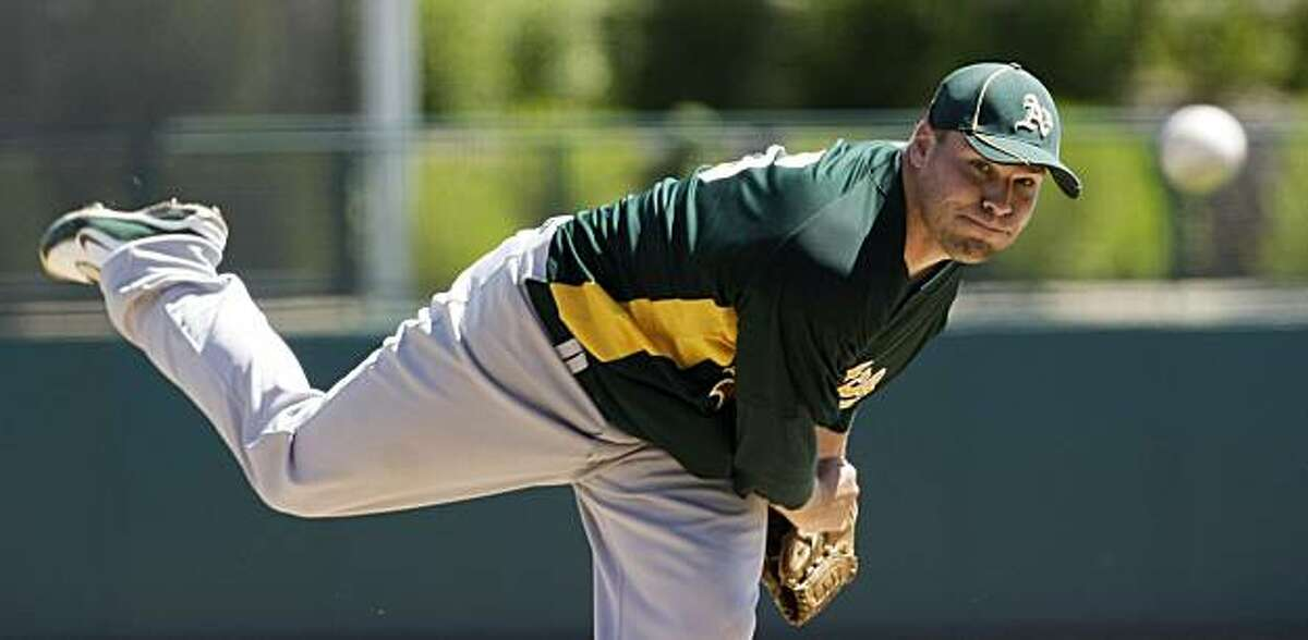 Oakland Athletics' Ben Sheets pitches in the first inning of a spring training baseball game against the Chicago White Sox on Tuesday, March 30, 2010 in Glendale, Ariz. Sheets pitched five and one-third innings and gave up three hits and one run. The White Sox won 2-0.