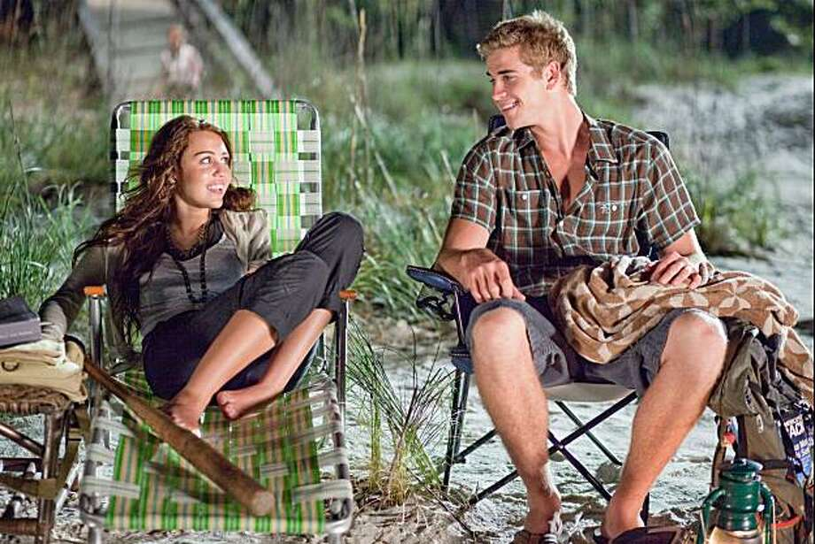 "Miley Cyrus and Liam Hemsworth star in ""The Last Song."" Photo: Sam Emerson SMPSP, Touchstone Pictures"