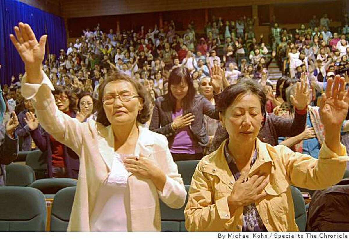 Mongolians pray at the Living Word Christian Church, an evengelical church with around 1000 members in Ulan Bator. It is located in the UB Palace, a large complex that on weekend nights is a nightclub and bar.