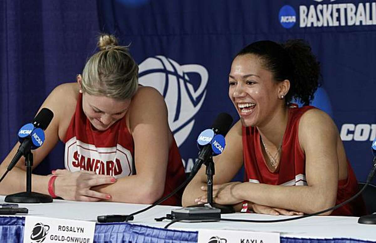 Stanford's Rosalyn Gold-Onwude, right, and Jayne Appel, left, laugh when questioned about of coach Tara VanDerveer's practice comments during a news conference in Sacramento, Calif., Sunday, March 28, 2010. Stanford defeat Georgia 73-36, Saturday, andwill play Xavier Monday night for the chance to go to the final four.