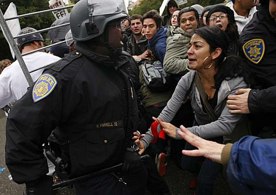 As students rally on the UC Berkeley campus in protest of pay cuts and layoffs, UC Ploice push back protesters as they move in barricades in front of Wheeler Hall in  Berkeley, Calif.  on Friday November 20, 2009. Photo: Michael Macor, The Chronicle