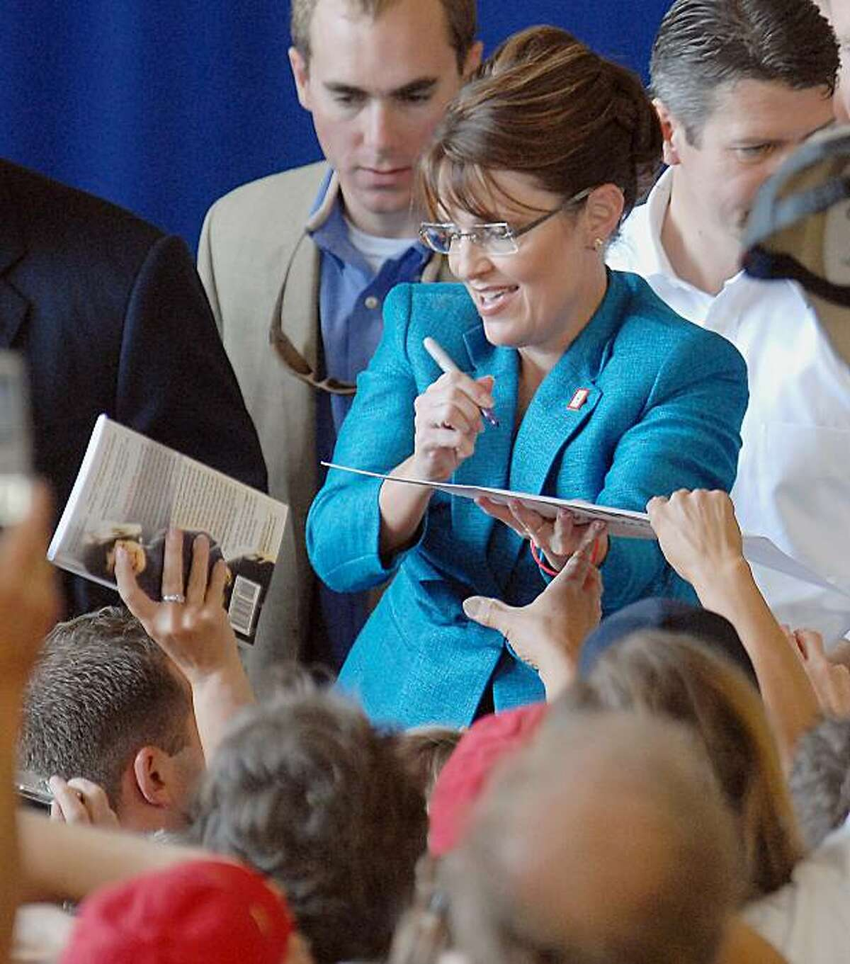 Republican vice presidential candidate, Alaska Gov. Sarah Palin, signs autographs, Friday, Sept. 19,2008, during a rally at the Anoka County Airport in Blaine, Minn. (AP Photo/Janet Hostetter)