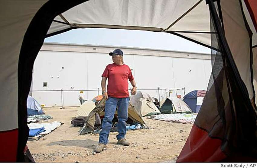 Sylvia Flynn, 51, stands outside her tent at the tent city that sprung up next to the homeless shelter in downtown Reno, Nev., Wednesday, June 25, 2008. Flynn has been homeless off and on for nearly 31 years she said. (AP Photo/Scott Sady)