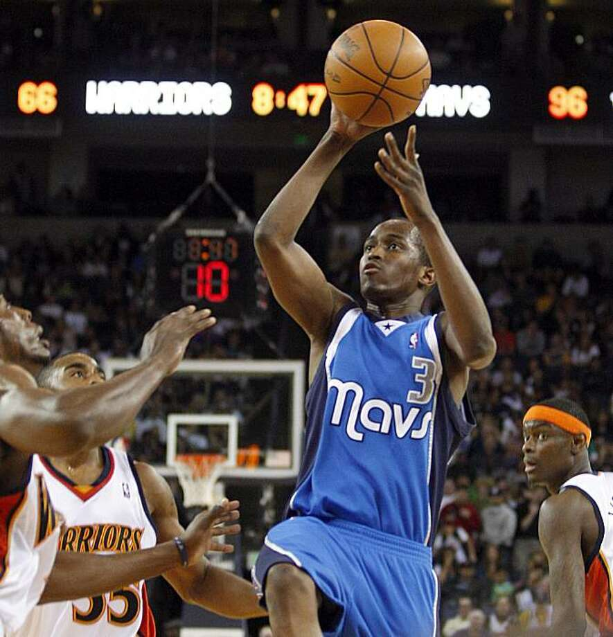 Dallas Mavericks' Rodrigue Beaubois (3) shoots against the Golden State Warriors during the fourth quarter of an NBA basketball game Saturday, March 27, 2010, in Oakland, Calif. Photo: Ben Margot, AP