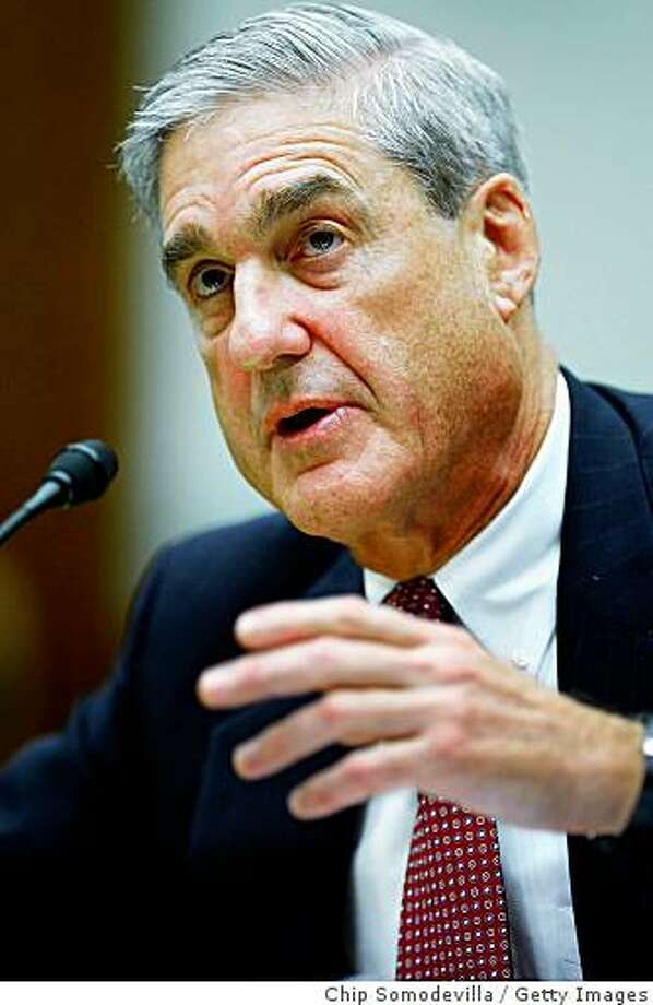 WASHINGTON - SEPTEMBER 16:  Federal Bureau of Investigation Director Robert Mueller answers questions from the House Judiciary Committee during a hearing on Captiol Hill September 16, 2008 in Washington, DC. The committee asked Mueller about the FBI's anthrax investigation, allegations of improper collection of information on reporters, the Bureau's approach to the mortgage fraud crisis, and the expanded investigative and intelligence gathering powers resulting from the proposed Attorney General Guidelines concerning the FBI's domestic operations.  (Photo by Chip Somodevilla/Getty Images) Photo: Chip Somodevilla, Getty Images